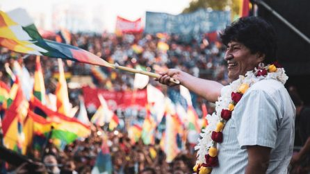 Image of Evo Morales waving a flag